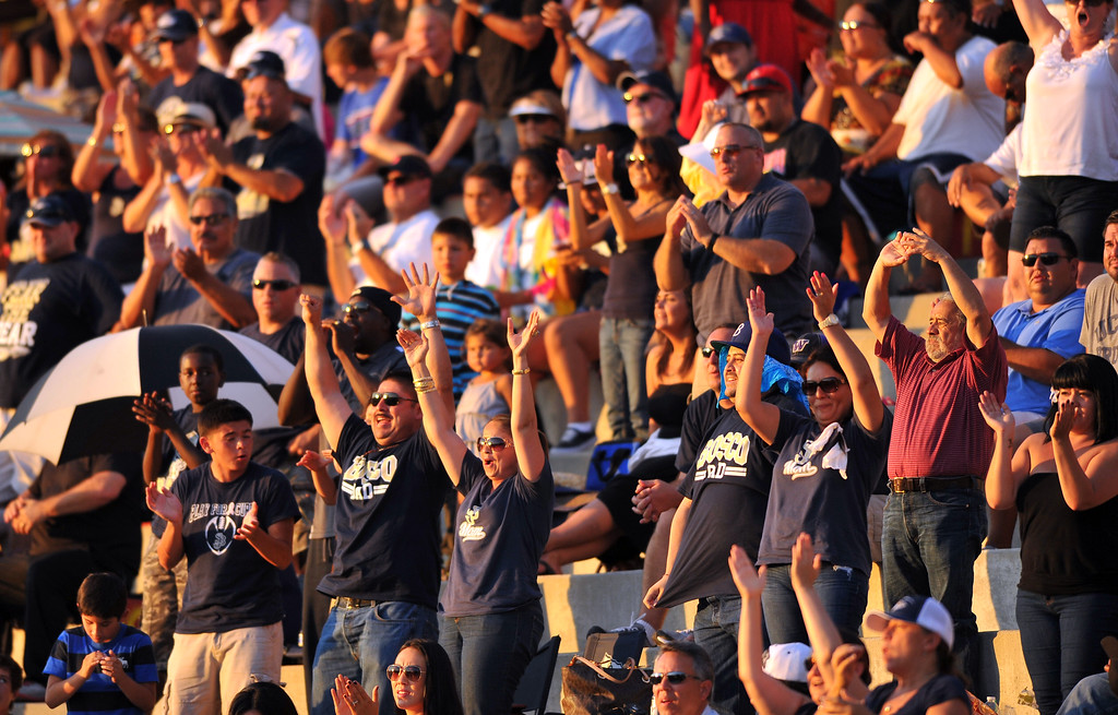 . St. John Bosco football takes on Chandler, Airzona as part of the Mission Viejo Classic in Mission Viejo, CA on Saturday, September 14, 2013. St. John Bosco won 52-31.  Bosco fans celebrate the TD to put them in the lead for good. (Photo by Scott Varley, Press-Telegram)