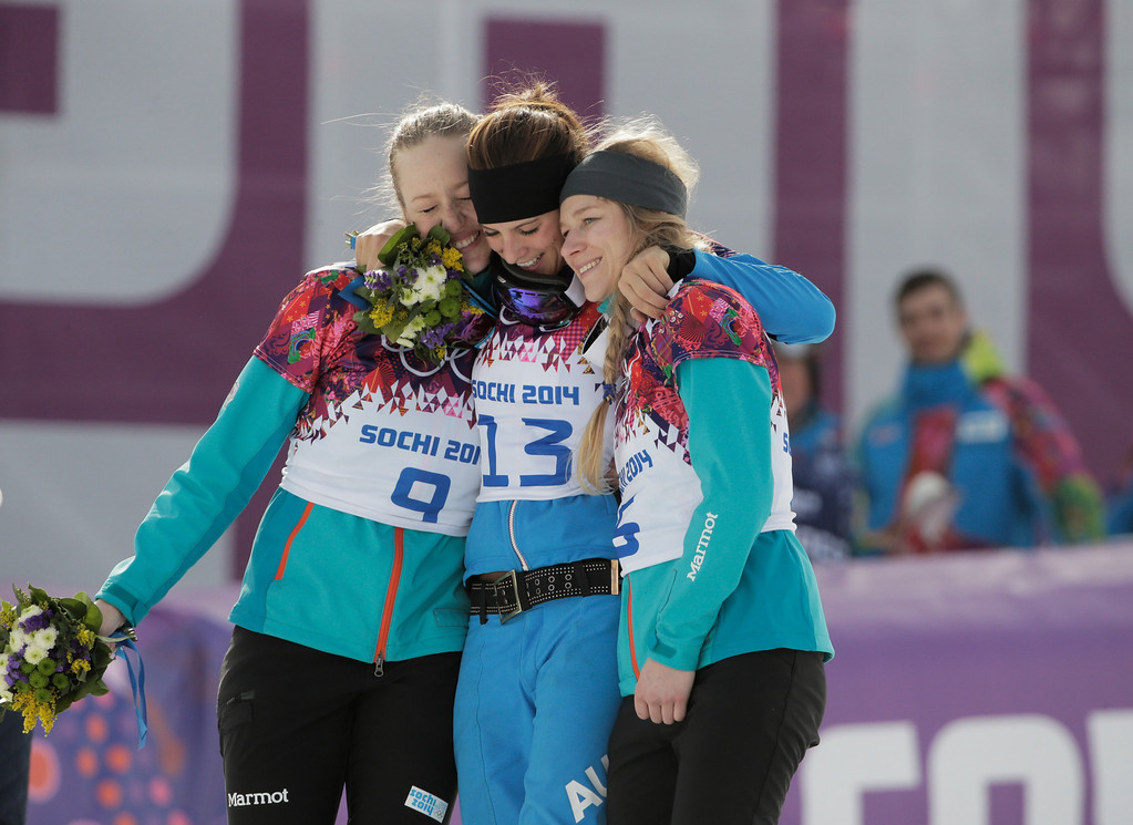 . SOCHI, RUSSIA - FEBRUARY 22:  Gold medalist Julia Dujmovits (C) of Austria celebrates with silver medalist Anke Karstens (L) of Germany and bronze medalist Amelie Kober (R) of Germany in the Snowboard Ladies\' Parallel Slalom Big Final on day 15 of the 2014 Winter Olympics at Rosa Khutor Extreme Park on February 22, 2014 in Sochi, Russia.  (Photo by Adam Pretty/Getty Images)