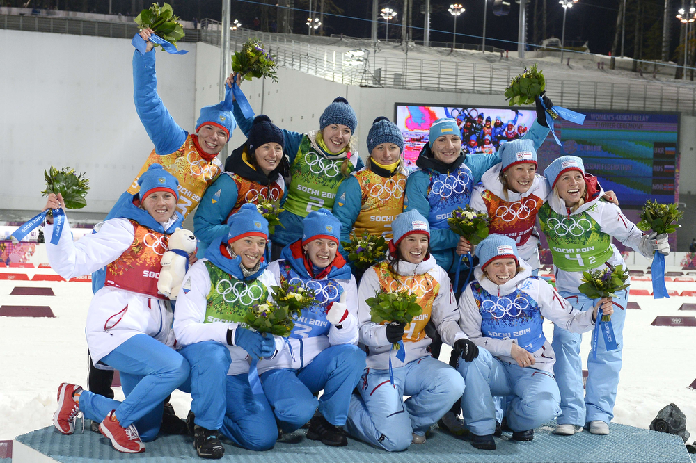 . From top left: Silver medalist Russia\'s Ekaterina Shumilova, gold medalists Ukraine\'s Vita Semerenko,  Juliya Dzhyma,  Valj Semerenko, Olena Pidhrushna and bronze medalists Norway\'s Fanny Welle-Strand Horn and Norway\'s Tiril Eckhoff., from bottom left: Silver medalists Russia\'s Yana Romanova, Olga Zaitseva, and Olga Vilukhina bronze medalists Norway\'s Ann Kristin Aafedt Flatland and Norway\'s Tora Berger celebrate on the podium their win in the Women\'s Biathlon 4x6 km Relay Flower Ceremony at the Laura Cross-Country Ski and Biathlon Center during the Sochi Winter Olympics on February 21, 2014, in Rosa Khutor, near Sochi. (PIERRE-PHILIPPE MARCOU/AFP/Getty Images)
