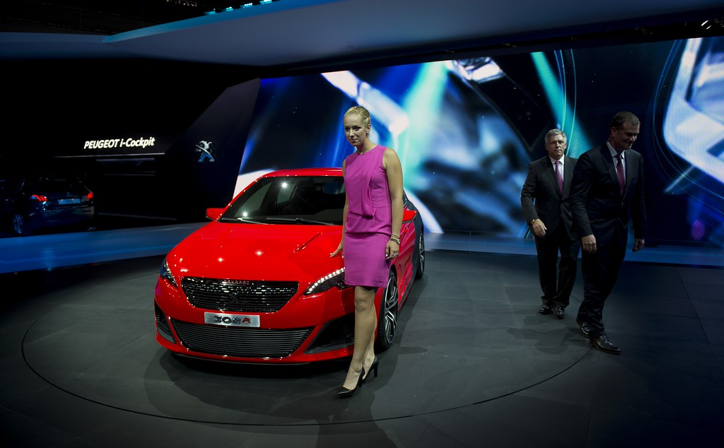 . German tennis player Sabine Lisicki poses next to a Peugeot  308 R concept car during the media day of the IAA (Internationale Automobil Ausstellung) international motor show in Frankfurt am Main, western Germany, on September 10, 2013.   AFP PHOTO / JOHANNES  EISELE/AFP/Getty Images