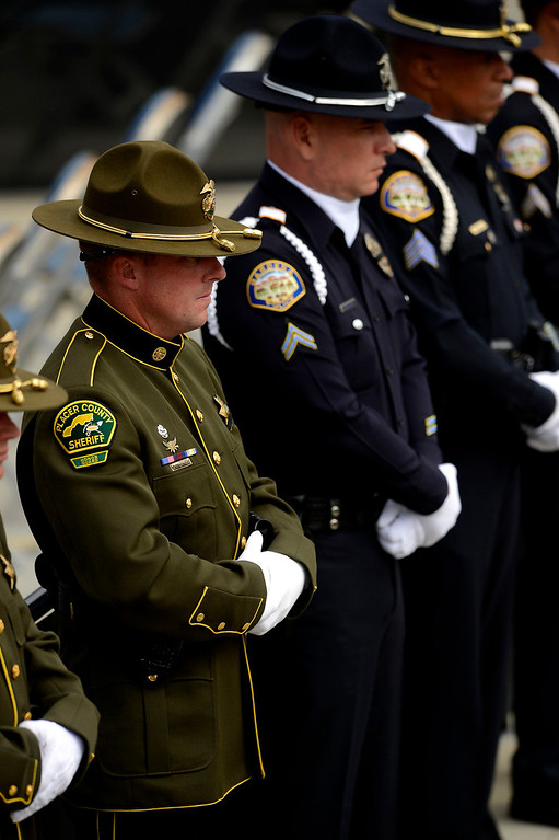 . A Placer County Sheriff Deputy stands at attention during  memorial services for San Bernardino County Sheriff Deputy Jeremiah MacKay at the San Manuel Amphitheater in Devore February 21, 2013.  GABRIEL LUIS ACOSTA/STAFF PHOTOGRAPHER.