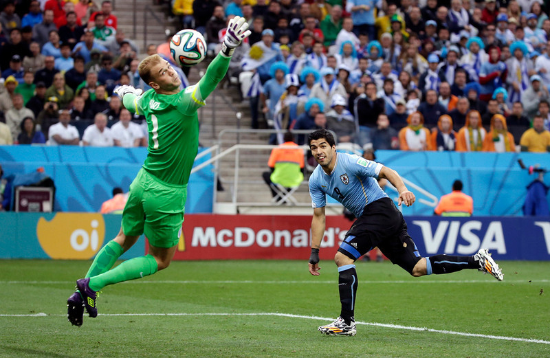 . England\'s goalkeeper Joe Hart can\'t stop Uruguay\'s Luis Suarez\'s header to score his side\'s first goal during the group D World Cup soccer match between Uruguay and England at the Itaquerao Stadium in Sao Paulo, Brazil, Thursday, June 19, 2014.  (AP Photo/Felipe Dana)