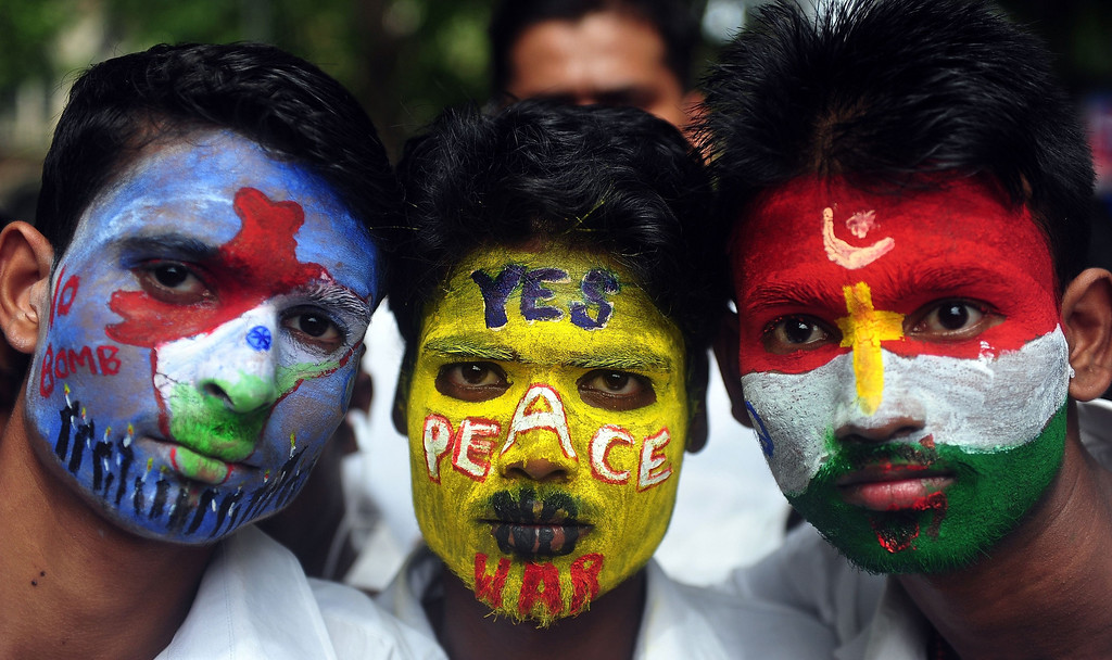 . Indian youths, their faces painted with peace messages, pose as they take part in a rally to mark Hiroshima Day in Mumbai on August 6, 2013, to mourn victims of the atomic bombing of Hiroshima in 1945.  AFP PHOTO/Indranil  MUKHERJEE/AFP/Getty Images