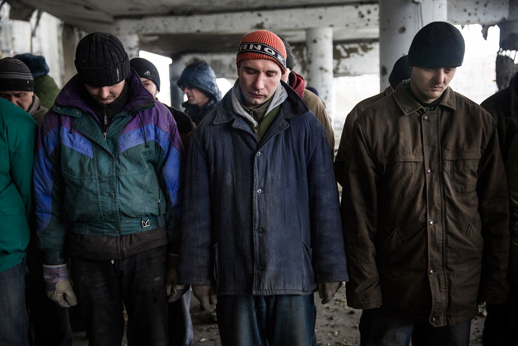 . DONETSK, UKRAINE - FEBRUARY 26:  Ukrainian soldier prisoners-of-war are lined up before being forced by pro-Russian rebels to search through the wreckage of the destroyed Donetsk airport for weaponry and dead bodies on February 26, 2015 in Donetsk, Ukraine. The Donetsk airport has been one of the most heavily fought over pieces of land between the Ukrainian army and pro-Russian rebels.  (Photo by Andrew Burton/Getty Images)