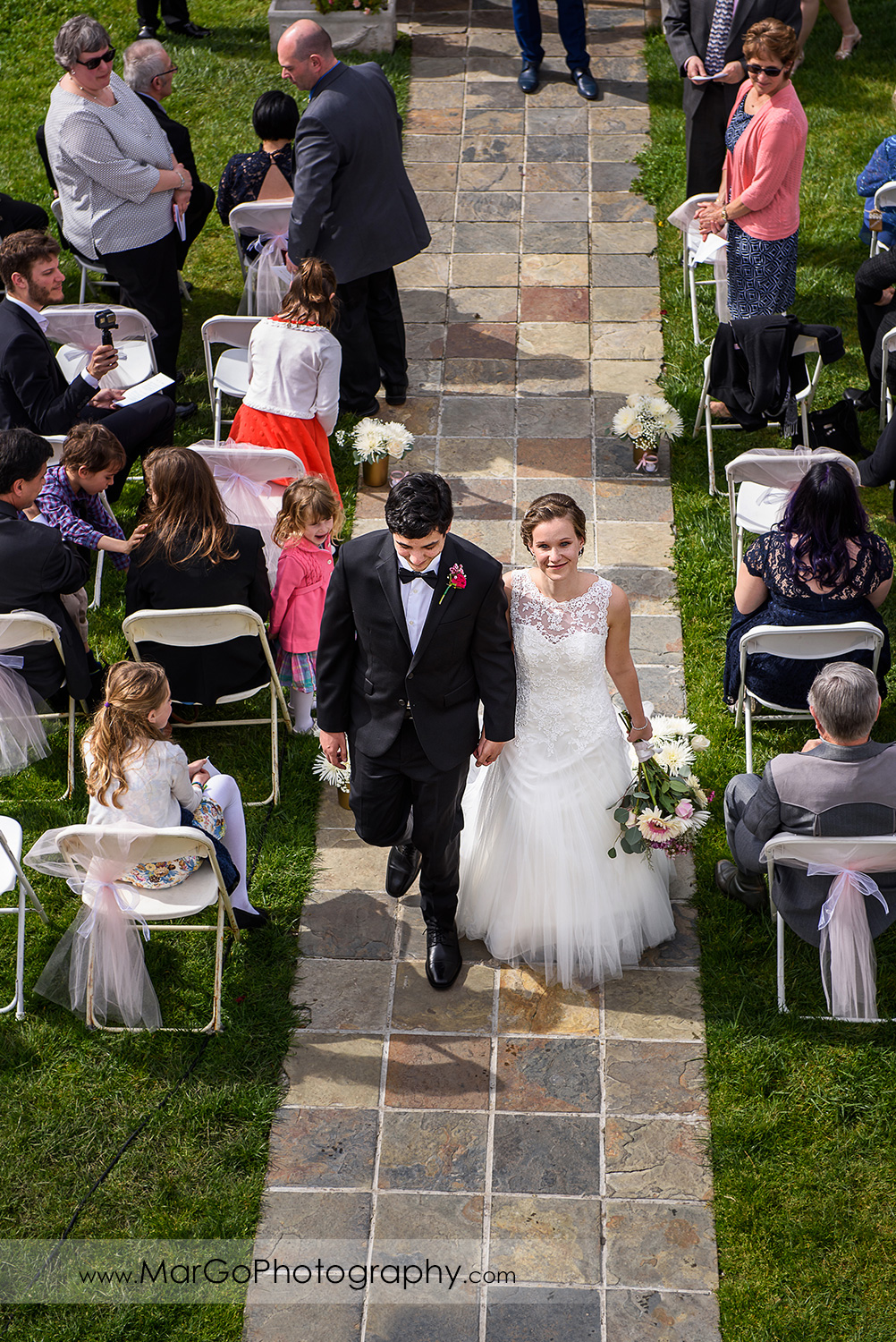 bride and groom walking down the aisle after wedding ceremony at Fremont Century House & Gardens