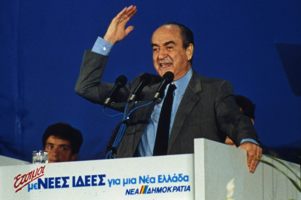 """. FILE - In this Greece, April 6, 1990, file photo, Greek Conservative New Democracy leader, Constantine Mitsotakis, gestures raising his hand at the end of his election campaign during a mass rally in Athens, Greece. Former Greek Prime Minister Mitsotakis\' family has put out a short statement saying Mitsotakis died Monday, May 29, 2017, \""""surrounded by those whom he loved and who loved him.\"""" He was 98. (AP Photo/Aris Saris, File)"""