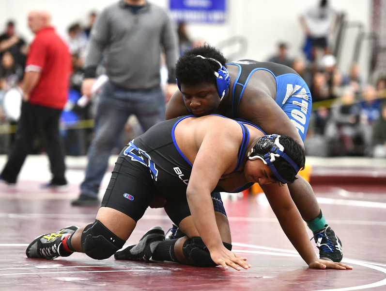 1/4/2020 Mike Orazzi | Staff Plainville's Bhavya Patel and Bristol Eastern's Derion Minngia in a 220 pound match at Saturday's wrestling tournament at Bristol Central High School.
