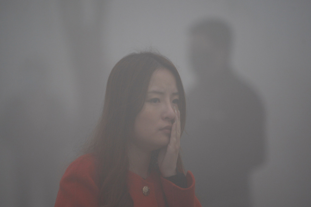 . A woman walks in the smog in Harbin, northeast China\'s Heilongjiang province, on October 21, 2013.    AFP PHOTOSTR/AFP/Getty Images