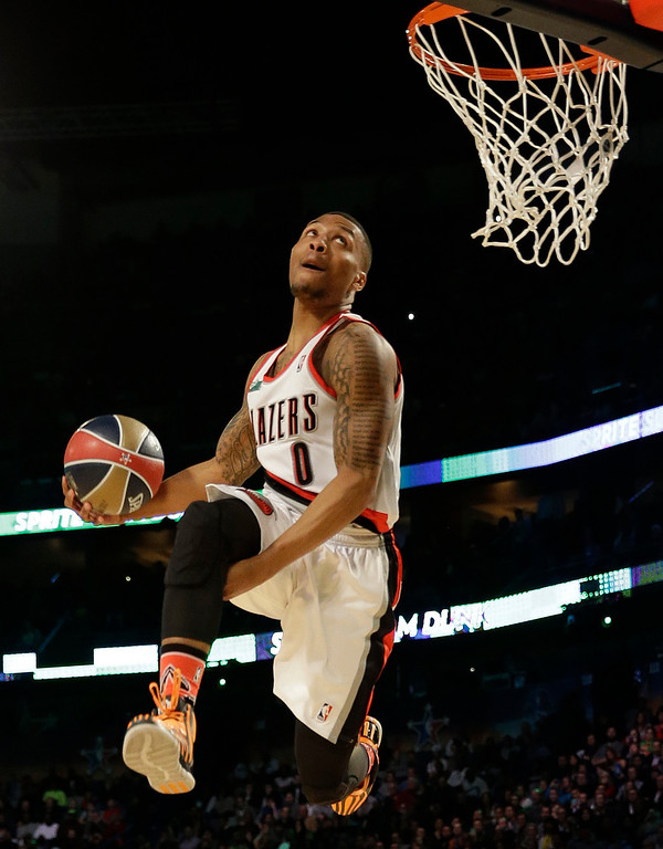 . Damian Lillard of the Portland Train Blazers participates in the slam dunk contest during the skills competition at the NBA All Star basketball game, Saturday, Feb. 15, 2014, in New Orleans. (AP Photo/Gerald Herbert)
