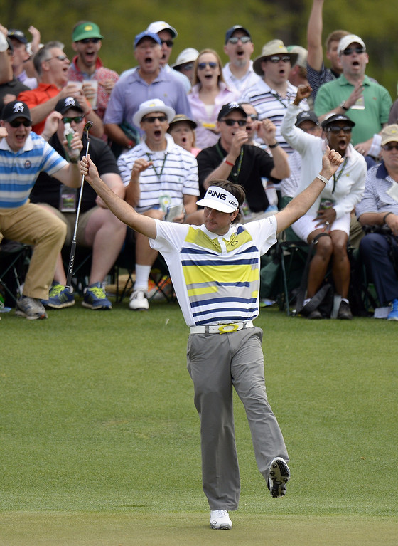 . Bubba Watson of the US reacts after making a birdie putt on the 14th green during the second round of the 78th Masters Golf Tournament at Augusta National Golf Club on April 11, 2014 in Augusta, Georgia. AFP PHOTO/Timothy A. CLARY/AFP/Getty Images