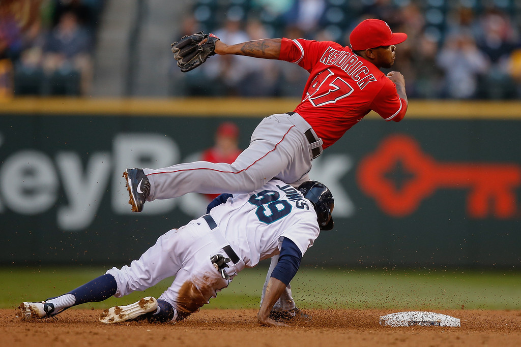 . Second baseman Howie Kendrick #47 of the Los Angeles Angels of Anaheim tries to turn a double play over James Jones #99 of the Seattle Mariners in the third inning at Safeco Field on May 28, 2014 in Seattle, Washington.  (Photo by Otto Greule Jr/Getty Images)
