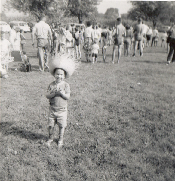 Brian fist full of pennies hat on at Camp St. Joseph.jpg