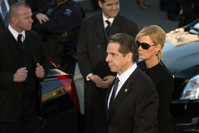 . New York Governor Andrew Cuomo arriveswith his girlfriend Sandra Lee outside the funeral of slain New York Police Department (NYPD) officer Rafael Ramos at the Christ Tabernacle Church on December 27, 2014 in the Glenwood section of the Queens borough of New York City. Ramos was shot, along with Police Officer Wenjian Liu while sitting in their patrol car in an ambush attack in Brooklyn on December 20. Thousands of fellow officers, family, friends and Vice President Joseph Biden arrived at the church for the funeral.  (Photo by Kevin Hagen/Getty Images)