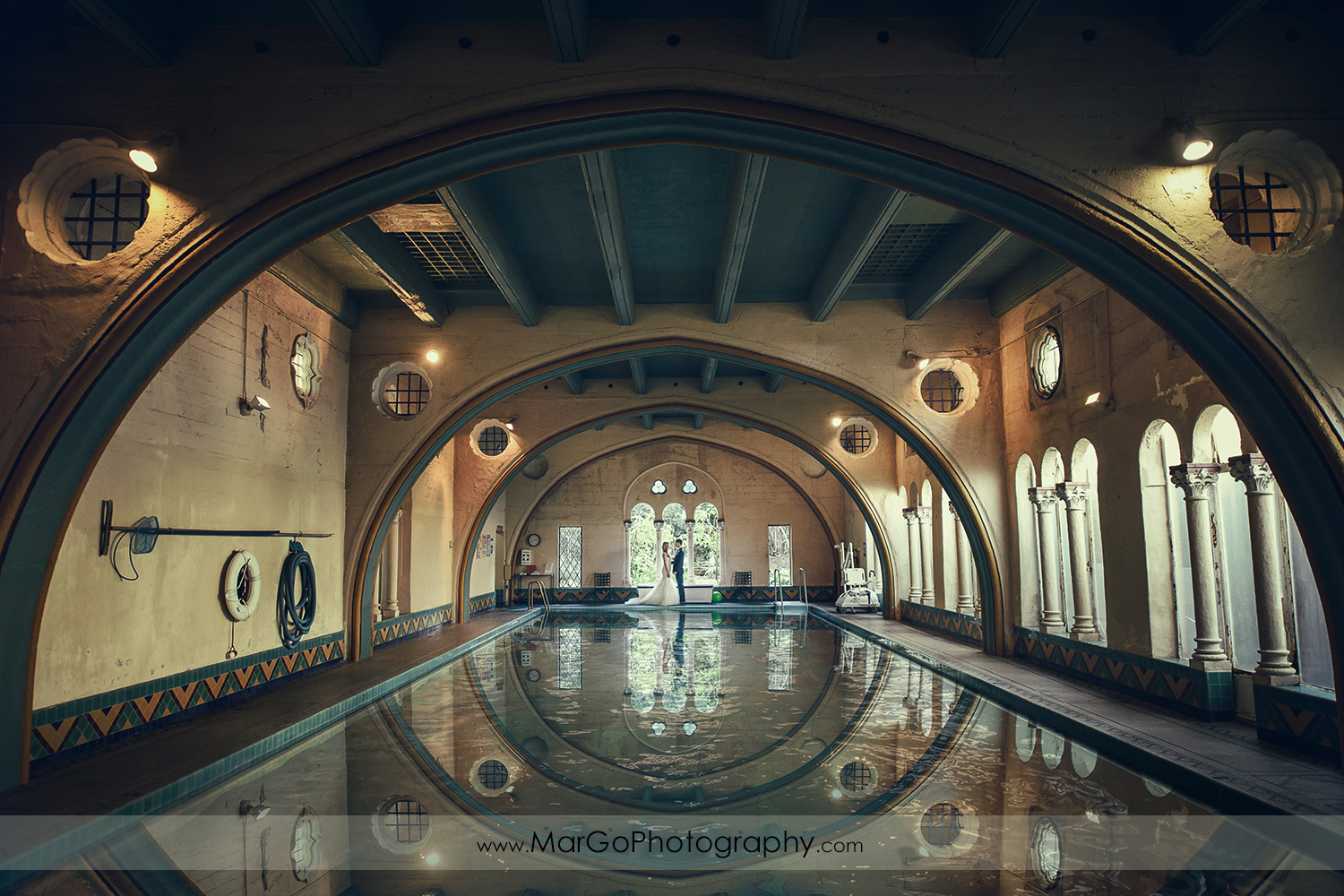 bride and groom at Berkeley City Club swimming pool