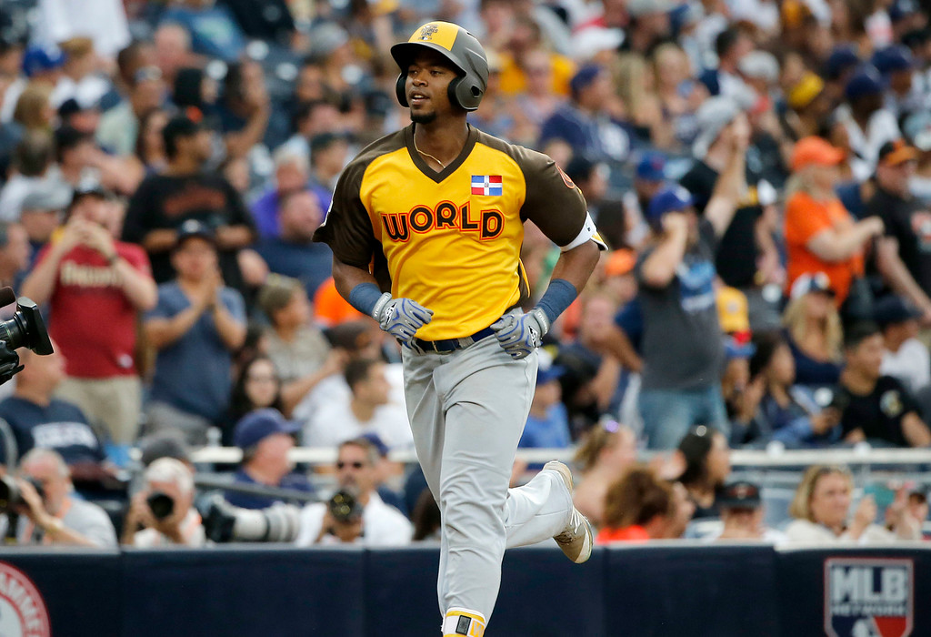 . World Team\'s Eloy Jimenez, of the Chicago Cubs, rounds the bases after hitting a three run home run against the U.S. Team during the ninth inning of the All-Star Futures baseball game, Sunday, July 10, 2016, in San Diego. (AP Photo/Lenny Ignelzi)