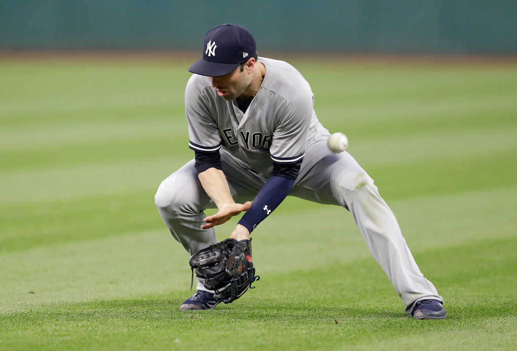 . New York Yankees\' Neil Walker lets a ball hit by Cleveland Indians\' Jason Kipnis get by during the sixth inning of a baseball game Thursday, July 12, 2018, in Cleveland. Kipnis was safe at second base on an error by Walker. (AP Photo/Tony Dejak)