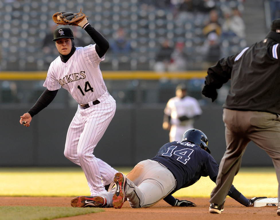 . DENVER, CO. - APRIL 23:  Colorado infielder Josh Rutledge looked for the call after the Rockies caught Atlanta baserunner Ramiro Pena off second base in the first inning. The Colorado Rockies hosted the Atlanta Braves in the second game of a doubleheader Tuesday night April 23, 2013 at Coors Field. Photo By Karl Gehring/The Denver Post