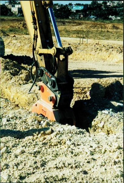 NPK C6C compactor on excavator-trenching (5).JPG