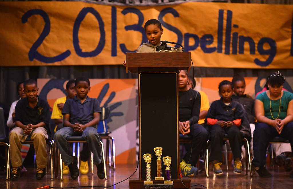 . Sankofa Academy third-grader Tristan Pontoon steps to the lectern as he participates in the school\'s second annual spelling bee in Oakland, Calif. on Wednesday, Jan. 23, 2013. (Kristopher Skinner/Staff)