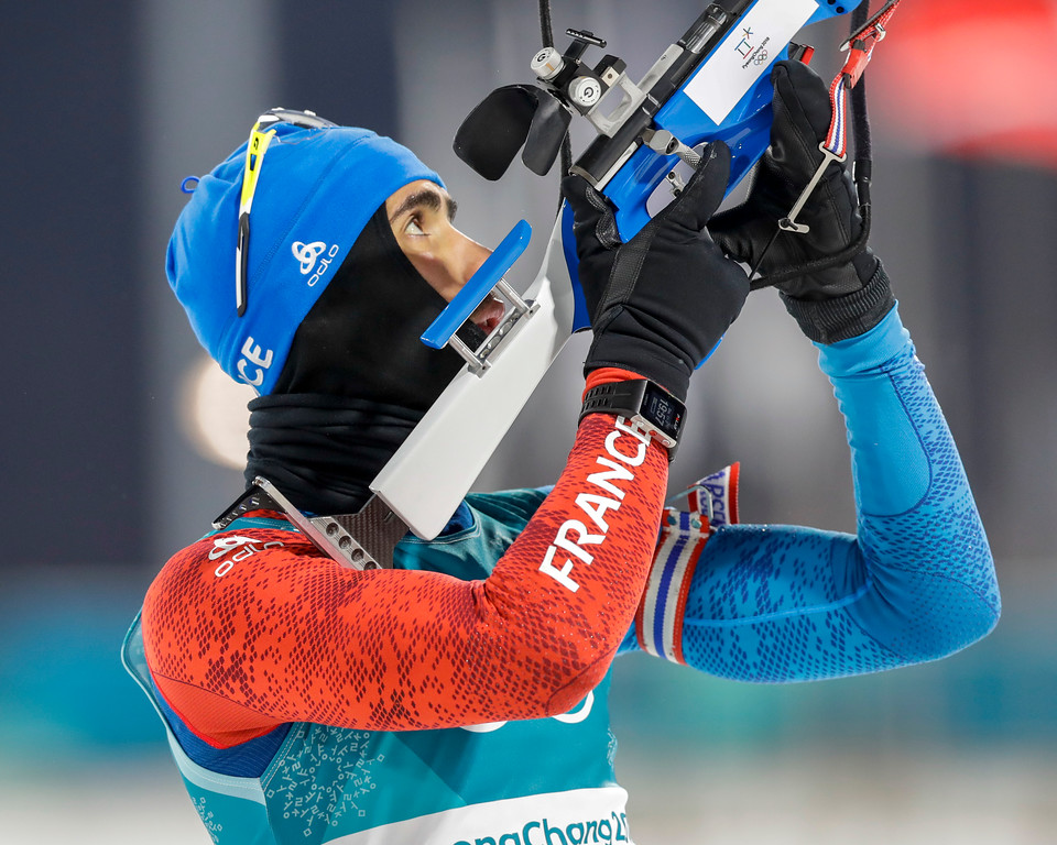 . Martin Fourcade, of France, looks over his rifle barrel before the start of the men\'s 10-kilometer biathlon sprint at the 2018 Winter Olympics in Pyeongchang, South Korea, Sunday, Feb. 11, 2018. (AP Photo/Andrew Medichini)