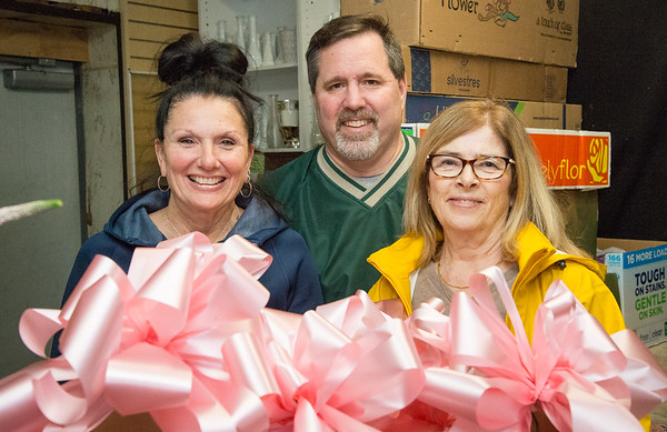 05/03/19 Wesley Bunnell | Staff Sharon Lapila, L Scott Hamel and Karen Irvine stand in front of just one box of many pink ribbons which will be hung up around the city this weekend in preparation for 2019 CT RACE in the Park by the Connecticut Breast Health Initiative. Lapila and Irvine donate their time to hand the ribbons through the downtown area and Walnut Hill Park while Scott Hamel , the owner of Scott's Flower Shop on Arch St, makes and donate the materials.
