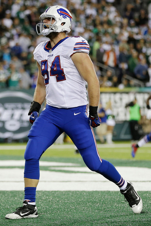 . Buffalo Bills tight end Scott Chandler (84) celebrates after scoring a touchdown during the second half of an NFL football game against the New York Jets Sunday, Sept. 22, 2013, in East Rutherford, N.J. (AP Photo/Seth Wenig)