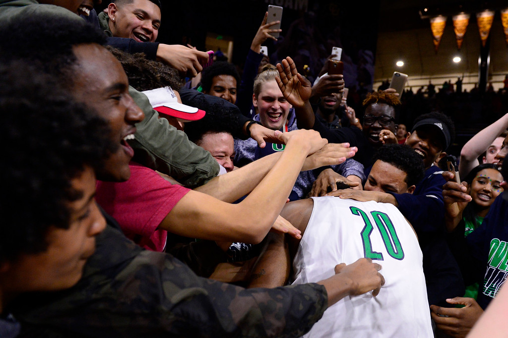 . Overland Trailblazers fans crowd around De\'ron Davis (20) of Overland Trailblazers after drafting Eaglecrest Raptors at the Coors Events Center on March 12, 2016 in Boulder, Colorado. Overland Trailblazers defeated Eaglecrest Raptors 66-56 to win the Colorado State 5A Basketball Championship.  (Photo by Brent Lewis/The Denver Post)