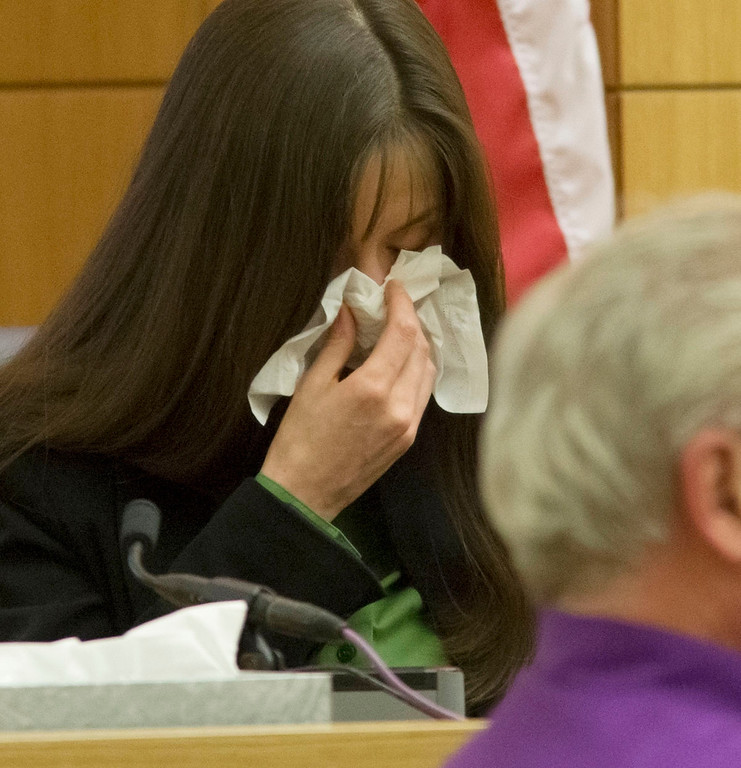 . Jodi Arias listens to audio of her and Travis Alexander during a phone call, in Maricopa County Superior Court in Phoenix, Tuesday, Feb. 12, 2013. Arias stands trial accused of murdering her lover, Travis Alexander, in the shower of his Mesa home in 2008. (AP Photo/The Arizona Republic, Mark Henle, Pool)