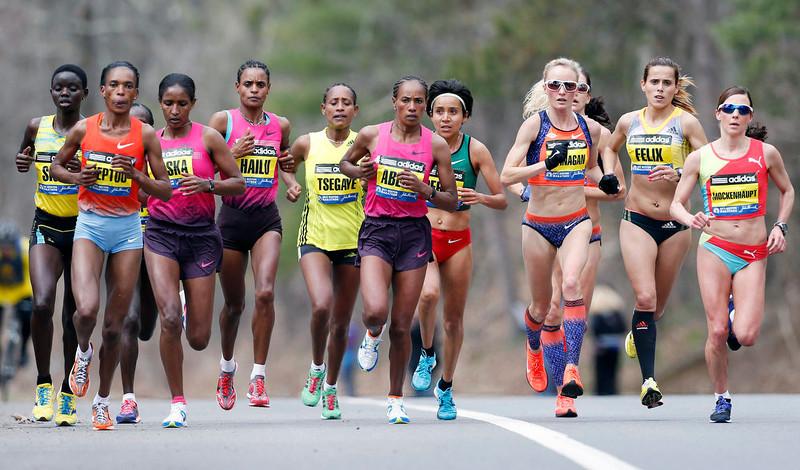 . Elite female marathoners, front row from left, Rita Jeptoo, Mamitu Daska, Meserat Debele, Tirifi Beyene, Alemitu Begna, Shalane Flanagan, Ana Felix and Sabrina Mockenhaupt compete on the course in Wellesley, Mass., Monday, April 15, 2013. (AP Photo/Michael Dwyer)