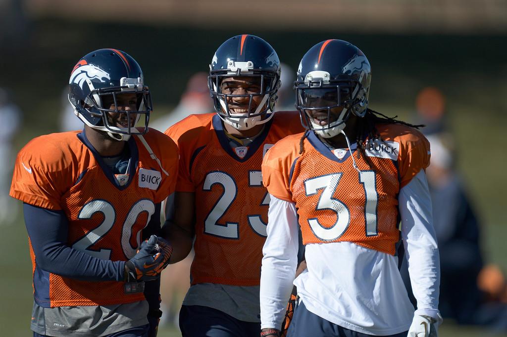 . Denver Broncos strong safety Mike Adams (20) Denver Broncos cornerback Quentin Jammer (23) and Denver Broncos cornerback Omar Bolden (31) all share a laugh during practice November 20, 2013 at Dove Valley (Photo by John Leyba/The Denver Post)