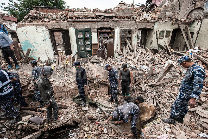 Rescuers dig through the rubble in the after math of the 7.9 magnitude earthquake that struck Nepal on Saturday.