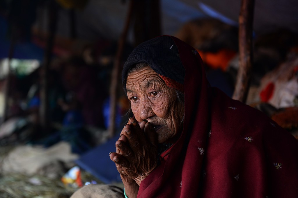 . A Nepalese villager woman sits inside a makeshift tent at Laprak village, in northern-central Gorkha district on April 30, 2015.  The UN launched an appeal for Nepalese quake survivors in dire need of shelter, food and medical care April 30 as anger boiled at the government\'s inability to cope with a disaster that has killed more than 5,000 people.  AFP PHOTO / SAJJAD HUSSAIN/AFP/Getty Images