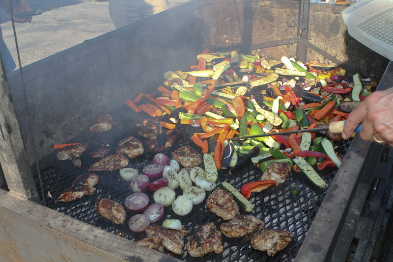 Loading up with veggies at the BBQ.