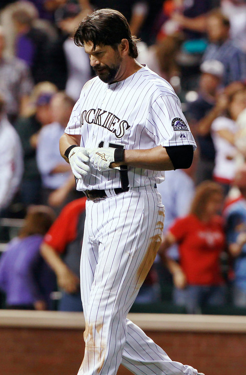 . Colorado Rockies\' Todd Helton reacts after striking out with the bases loaded against the St. Louis Cardinals to end the baseball game in Denver on Wednesday, Sept. 18, 2013. The Cardinals won 4-3. (AP Photo/David Zalubowski)