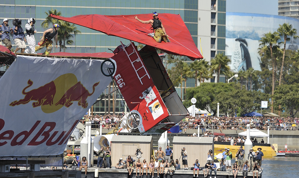 """. LONG BEACH, CALIF. USA -- Flugtag entry \""""The Hosers\"""" in Rainbow Harbor in Long Beach, Calif. on August 21, 2010. Thirty five teams competed in the Red Bull event where teams build homemade, human-powered flying machines and pilot them off a 30-foot high deck in hopes of achieving flight.  Flugtag means \""""flying day\"""" in German. They are on distance, creativity and showmanship..Photo by Jeff Gritchen / Long Beach Press-Telegram.."""