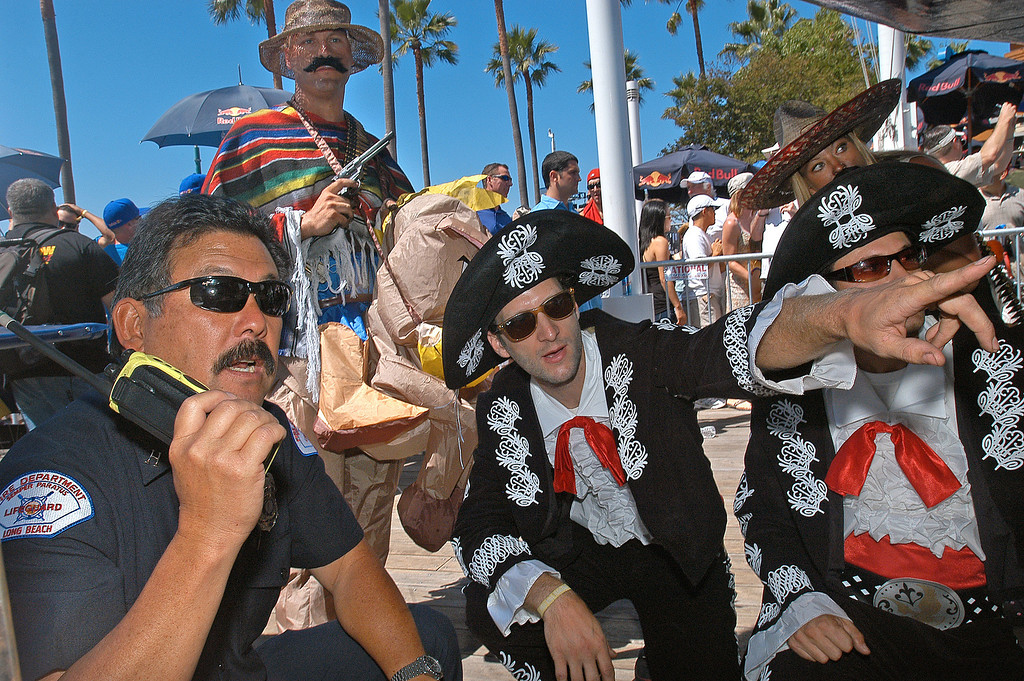 . 08/21/10:  Long Beach firefighter inspects the craft of Team Three Amigos, of Los Angeles, prior to their team\'s flight at the Red Bull Flugtag Long Beach at Rainbow Harbor on Saturday, August 21, 2010..Photo by Diandra Jay/Press-Telegram