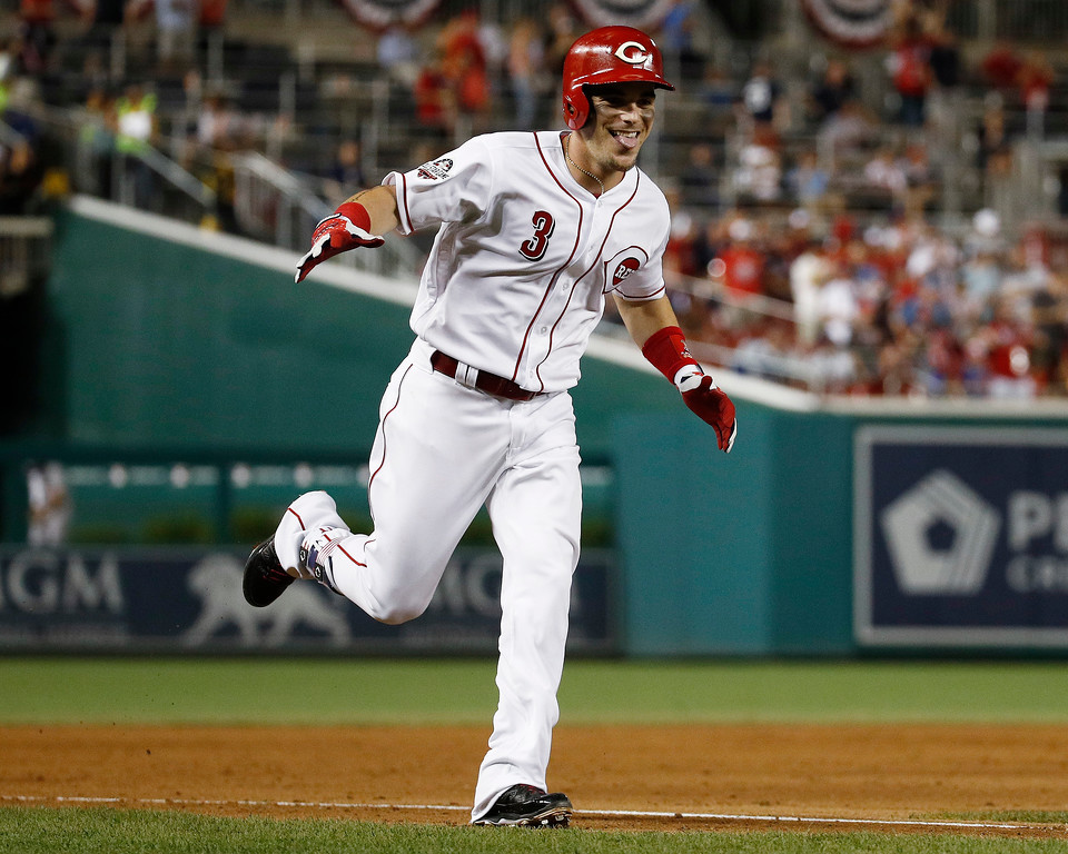 . Cincinnati Reds Scooter Gennett (3) celebrates his two-run homer in the ninth inning during the Major League Baseball All-star Game, Tuesday, July 17, 2018 in Washington. (AP Photo/Patrick Semansky)