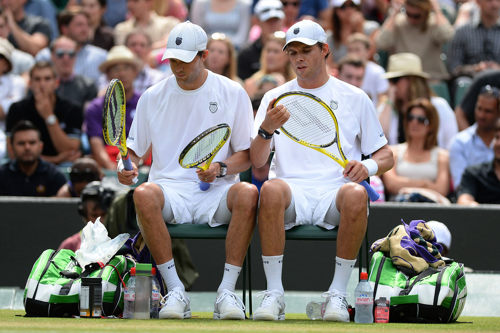 . LONDON, ENGLAND - JULY 04:  Bob Bryan and Mike Bryan of the United States of America speak during a break in their Gentlemen�s Doubles semi final match against Rohan Bopanna of India and Edouard Roger-Vasselin of France on day ten of the Wimbledon Lawn Tennis Championships at the All England Lawn Tennis and Croquet Club on July 4, 2013 in London, England.  (Photo by Mike Hewitt/Getty Images)