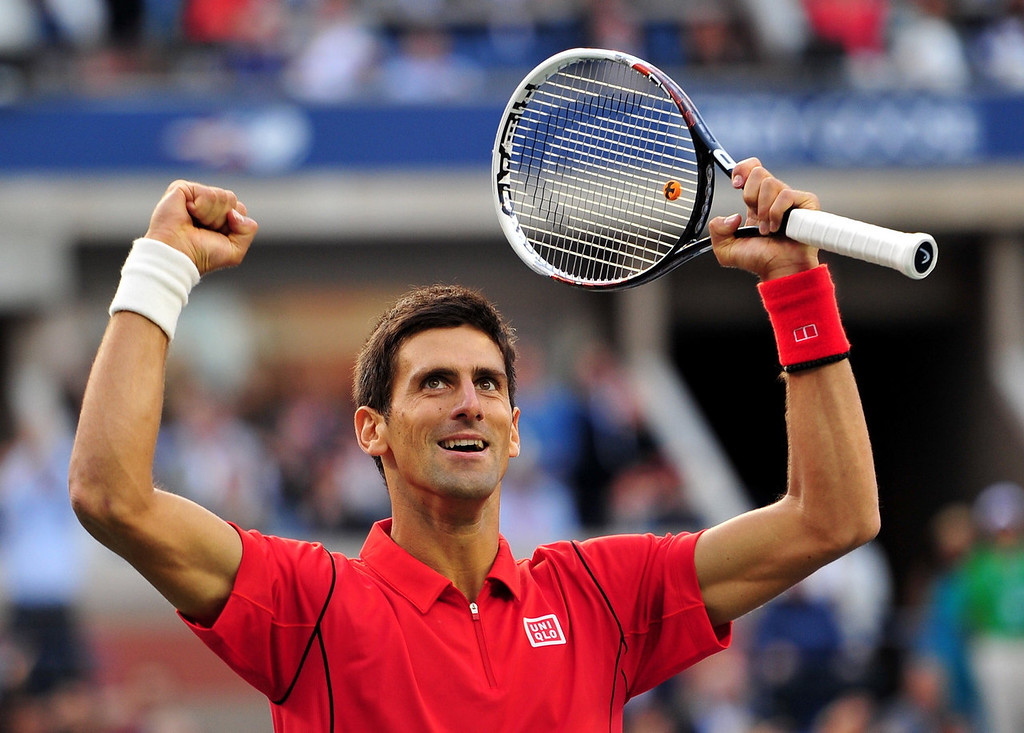 . Novak Djokovic of Serbia reacts after winning a game in the second set against Rafael Nadal of Spain during their 2013 US Open men\'s singles final match at the USTA Billie Jean King National Tennis Center September 9, 2013 in New York.   STAN HONDA/AFP/Getty Images