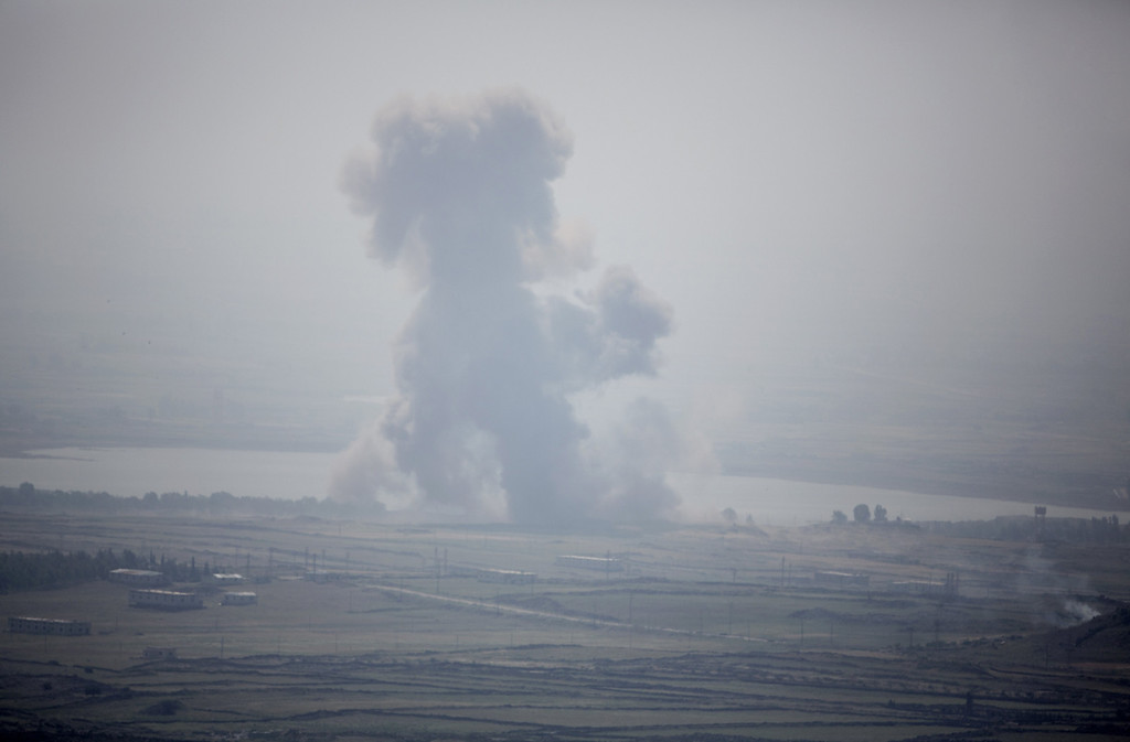 . A picture taken from the Israeli annexed Golan Heights shows smoke rising following an explosion in a Syrian village near the Israeli border on May 7, 2013. The conflict between President Bashar al-Assad\'s government and rebel forces has divided the Middle East, with his allies -- Iran and Lebanon\'s Hezbollah -- lined up against Gulf states which back the uprising. MENAHEM KAHANA/AFP/Getty Images