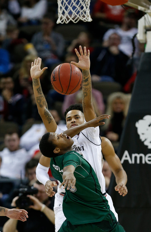 . Cleveland State guard Dontel Highsmith, front, has the ball knocked loose by Cincinnati forward Kyle Washington, rear, during the second half of an NCAA college basketball game Thursday, Dec. 21, 2017, in Highland Heights, Ky. Cincinnati won 81-62. (AP Photo/Gary Landers)