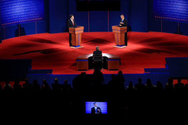 ". Democratic presidential candidate, U.S. President Barack Obama (R) speaks as Republican presidential candidate, former Massachusetts Gov. Mitt Romney listens during the Presidential Debate at the University of Denver on October 3, 2012 in Denver, Colorado. The first of four debates for the 2012 Election, three Presidential and one Vice Presidential, is moderated by PBS\'s Jim Lehrer and focuses on domestic issues:  the economy, health care, and the role of government. ""Presidential Debate\"" ranked as Google\'s sixth most searched trending event of 2012. (Photo by Doug Pensinger/Getty Images)"