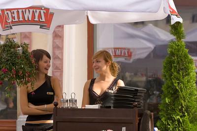Poland, Cracow, waitresses in a bar on Rynek Glowny