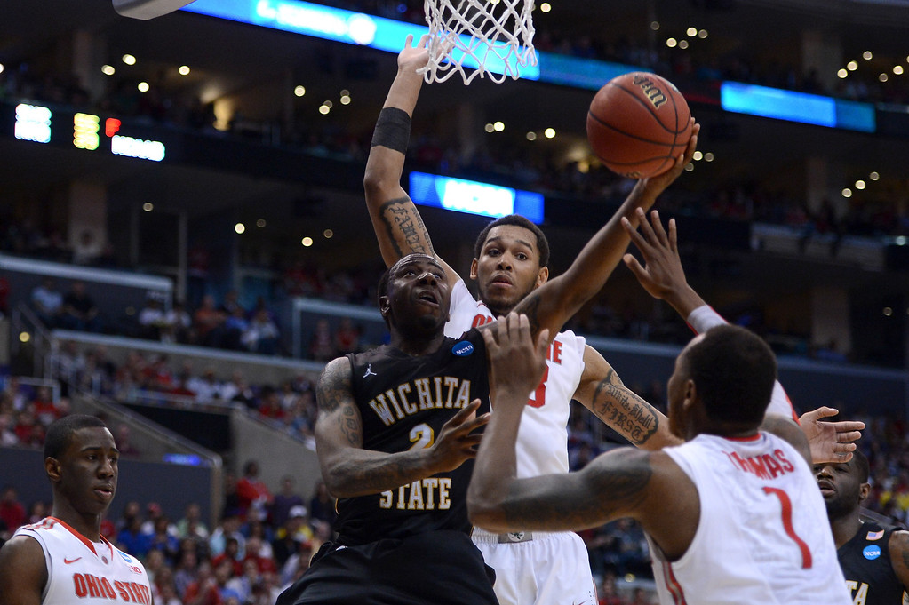 . LOS ANGELES, CA - MARCH 30:  Malcolm Armstead #2 of the Wichita State Shockers goes up for a shot against Deshaun Thomas #1 and Amir Williams #23 of the Ohio State Buckeyes in the first half during the West Regional Final of the 2013 NCAA Men\'s Basketball Tournament at Staples Center on March 30, 2013 in Los Angeles, California.  (Photo by Harry How/Getty Images)