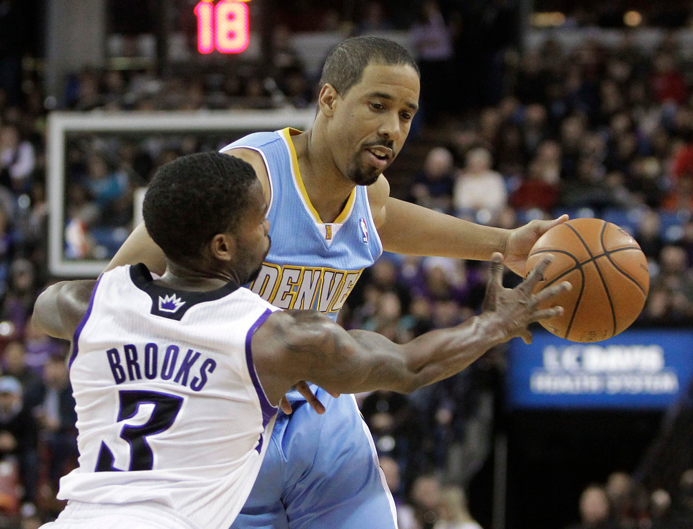 . Denver Nuggets guard Andre Miller, right, protects the ball from Sacramento Kings guard Aaron Brooks during the first quarter of an NBA basketball game in Sacramento, Calif., Sunday, Dec. 16, 2012.(AP Photo/Rich Pedroncelli)