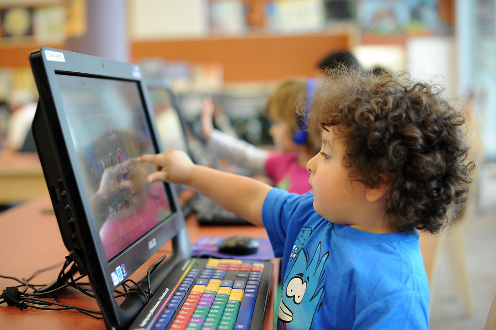 . Damien Castro enjoys the children\'s computer lab at the Old Town Newhall Library November 12, 2103.  Libraries have evolved into more comfortable places that cater to digital reading habits, with computers and more public meeting spaces.(Andy Holzman/Los Angeles Daily News)