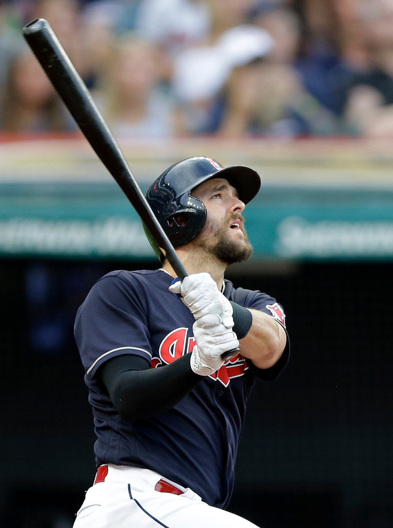 . Cleveland Indians\' Lonnie Chisenhall watches an RBI sacrifice fly against San Diego Padres starting pitcher Dinelson Lamet during the third inning of a baseball game, Thursday, July 6, 2017, in Cleveland. (AP Photo/Tony Dejak)