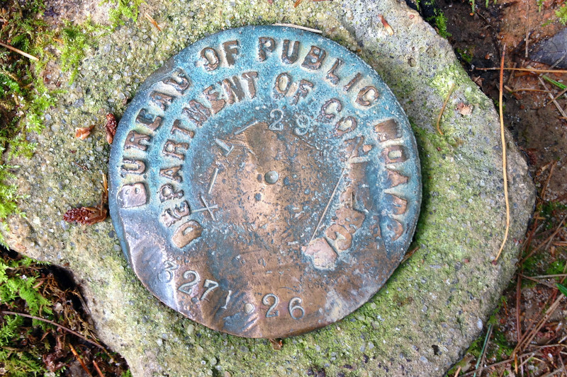 I found this old, rather beat up benchmark not far from the end of the loop.  If I read it correctly it was placed in 1929 and is at a measured elevation of 3,271 feet...