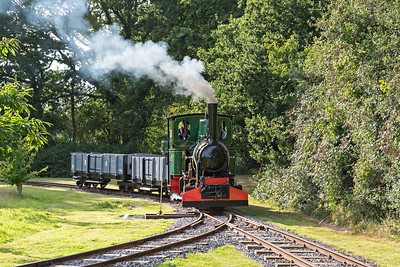 O&K No3136 Susan passes the loop with open bogie wagons