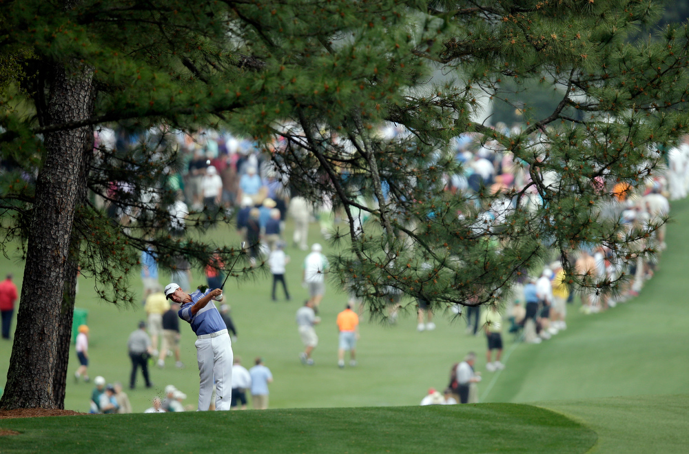 Description of . Webb Simpson hits off the first fairway during the first round of the Masters golf tournament Thursday, April 11, 2013, in Augusta, Ga. (AP Photo/Matt Slocum)